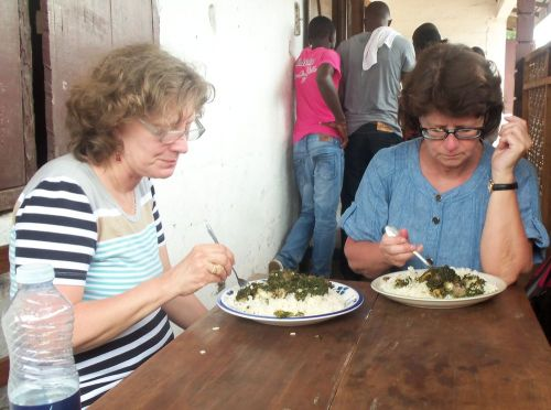 Elisabeth and Marianne eating potato greens and rice