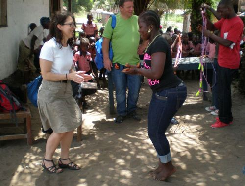 Lena and Veronica, a female teacher, playing knock foot