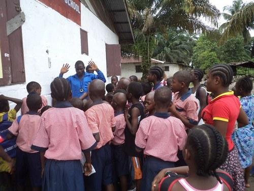 Children listening to Mr. Joseph Goffa, Vice principal for Student affairs