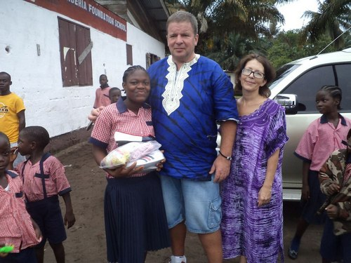 Lena and Anders posing with one of their sponsored children – Rita Bryant – after giving her special gifts