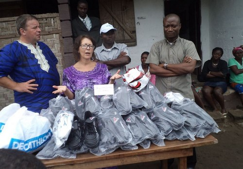 Lena making remarks after presenting the 25 pairs of boots to the school