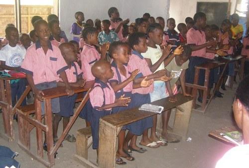 Students singing at the closing program