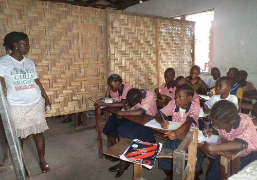 Female teacher Philemina teaching in class