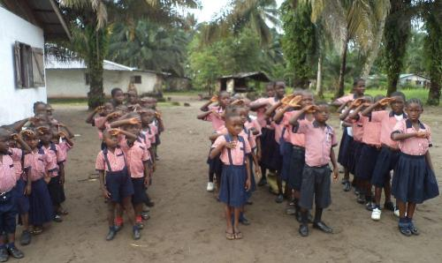 Kids saluting the Liberian Flag at school