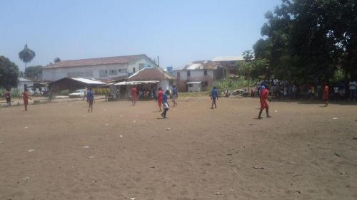 Our boys and the boys of James Teah School playing on the field