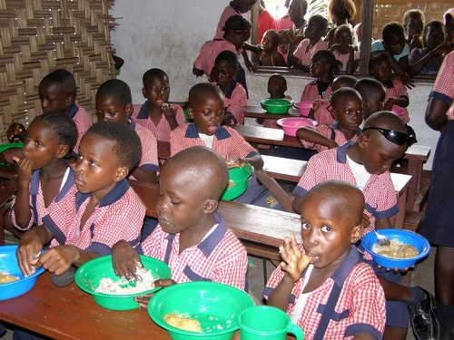 Students enjoying bean rice