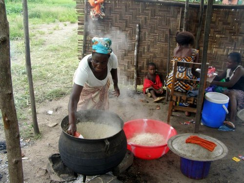 The school's cook dishing out rice for the country cook
