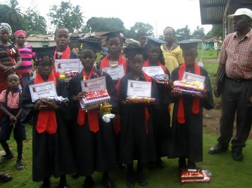 A cross-section of the graduates posing for after the program