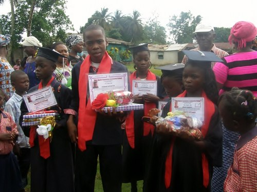 Some of the graduates – the bigger boy is the lone graduate from the Sixth Grade