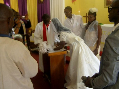 Couple signing their certificate