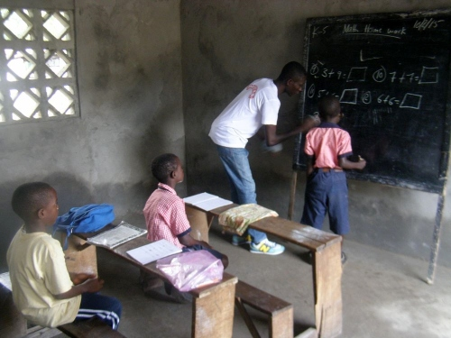 Teacher and students interacting in the K-4 classroom in the annex