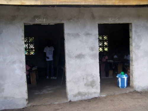 The two doors of the annex, with students in the classes in the background