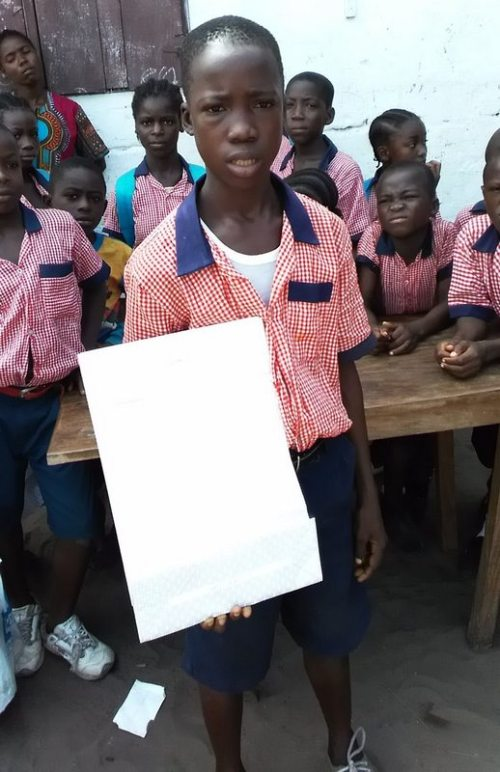 One of Elizabeth sponsored children displays his parcel