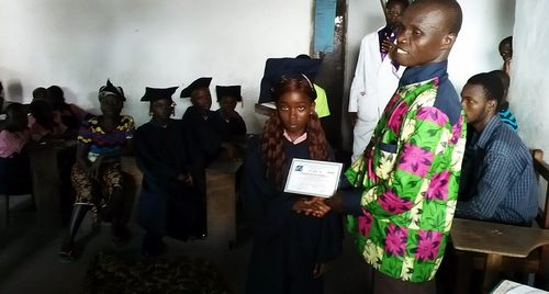 A graduate receiving certificate during the occasion