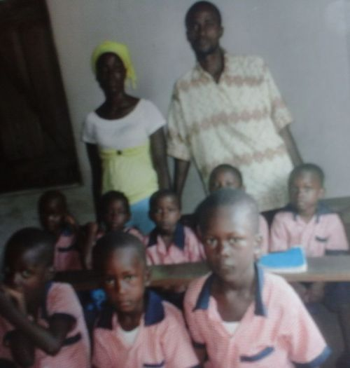 The Principal and a teacher posing with some kids
