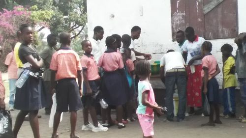 Some of the kids standing in line to receive their portion
