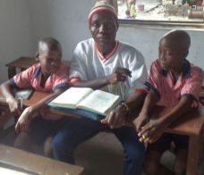 A teacher explaining the lesson to two kids