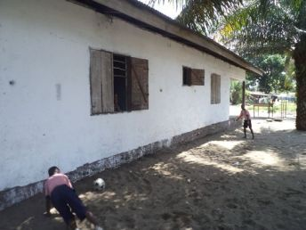 Kids playing football at the school
