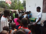 Lena distributing some rice she had bought for the kids