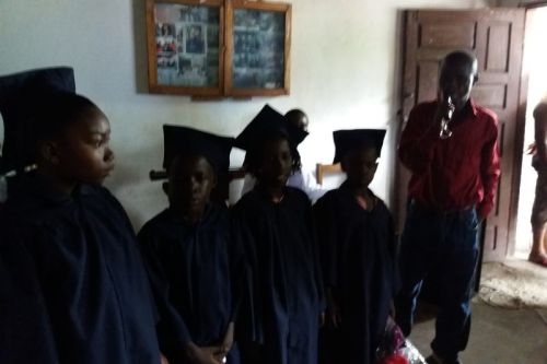 The four kindergarten graduates being presented to the audience