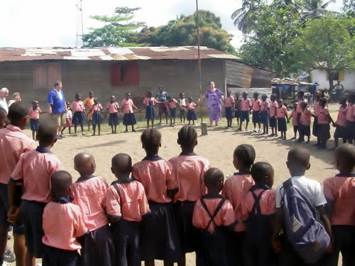 Anders (in blue African shirt) and Lena (in Purple African dress) during one of their visits at the school in 2013