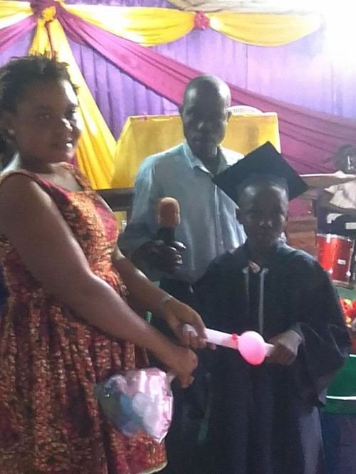 Guest Speaker Remmie presenting certificate to one of the graduates