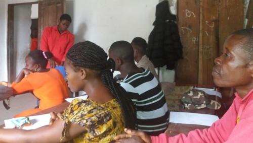 Teachers listening to a lecturer
