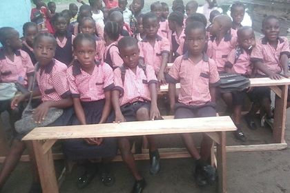 Kids sitting on the desks 2