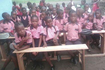 Kids sitting on the desks upon arrival