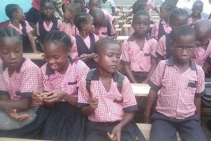 Kids sitting on the desks